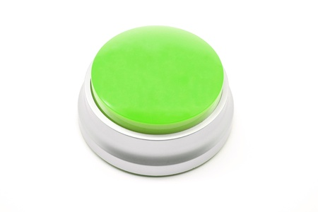 Large Green push button photographed on a white background Banco de Imagens