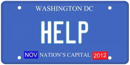 Een imitatie Washington DC kenteken met Help op geschreven en januari 2014 stickers. Woorden on Capital de onderkant Nation's. Stockfoto