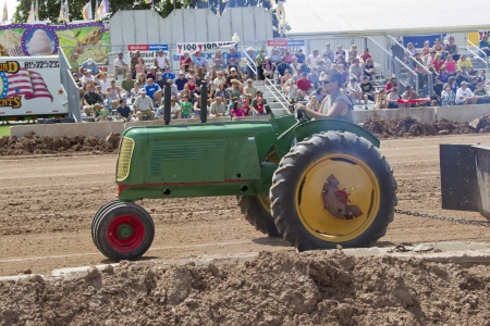 DE PERE, WI - AUGUST 18: Side view of Green Oliver Tractor competing at the Tractor Pull event at the Brown County Fair on August 18, 2012 in De Pere, Wisconsin.