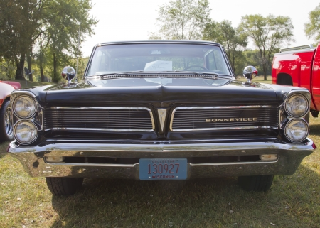 antique car: MARION, WI - SEPTEMBER 16: Front grill view of 1963 Black Pontiac Bonneville car at the 3rd Annual Not Just Another Car Show on September 16, 2012 in Marion, Wisconsin.