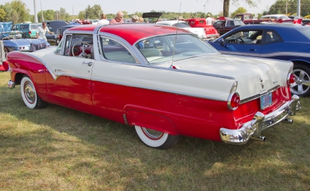 antique car: MARION, WI - SEPTEMBER 16: Side view of 1955 Red & White Ford Crown Victoria Fairlane Fordomatic car at the 3rd Annual Not Just Another Car Show on September 16, 2012 in Marion, Wisconsin.