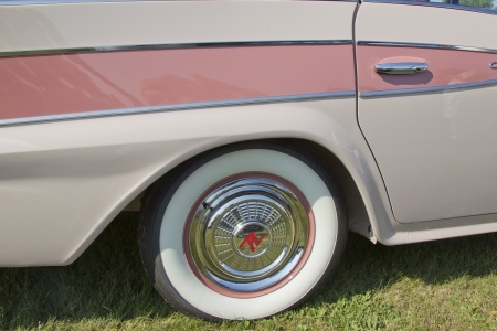 rambler: MARION, WI - SEPTEMBER 16: White Wall Tire of 1959 Pink Rambler car at the 3rd Annual Not Just Another Car Show on September 16, 2012 in Marion, Wisconsin.
