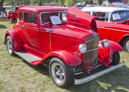 MARION, WI - SEPTEMBER 16: 1930 Red Ford Coupe car at the 3rd Annual Not Just Another Car Show on September 16, 2012 in Marion, Wisconsin.