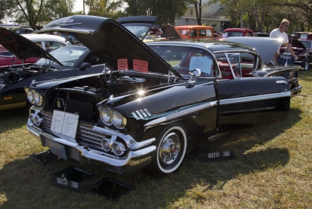 MARION, WI - SEPTEMBER 16: 1958 black Chevy Impala car at the 3rd Annual Not Just Another Car Show on September 16, 2012 in Marion, Wisconsin. Stock Photo - 17437291