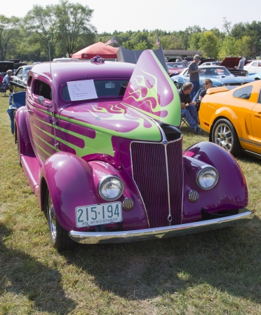 antique car: MARION, WI - SEPTEMBER 16: Purple 1936 Ford Coupe car at the 3rd Annual Not Just Another Car Show on September 16, 2012 in Marion, Wisconsin. Editorial