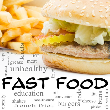 A burger and fries fast food Word Cloud Concept with great terms such as unhealthy, fat, grease, hamburger, meal and more. Stock Photo