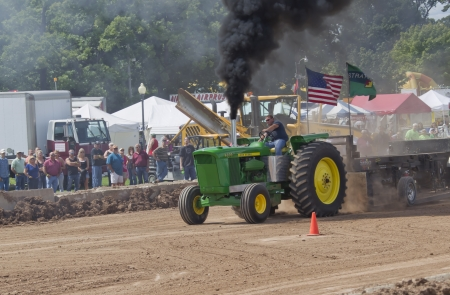 deere: DE PERE, WI - AUGUST 18: Black smoke on John Deere 6030 tractor competing at the Tractor Pull event at the Brown County Fair on August 18, 2012 in De Pere, Wisconsin.