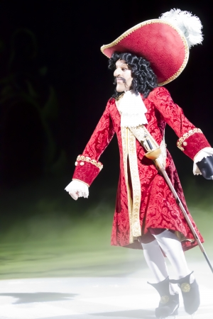 treasure trove: GREEN BAY, WI - MARCH 10: Captain Hook in red coat, hat and skates at the Disney on Ice Treasure Trove show at the Resch Center on March 10, 2012 in Green Bay, Wisconsin.