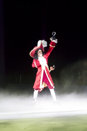 treasure trove: GREEN BAY, WI - MARCH 10: Captain Hooks big entrance in red coat, hat and skates at the Disney on Ice Treasure Trove show at the Resch Center on March 10, 2012 in Green Bay, Wisconsin.