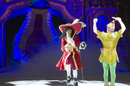 treasure trove: GREEN BAY, WI - MARCH 10: Captain Hook and Peter Pan square off to fight on skates at the Disney on Ice Treasure Trove show at the Resch Center on March 10, 2012 in Green Bay, Wisconsin.
