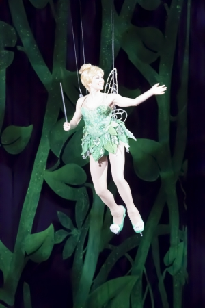 tinker bell: GREEN BAY, WI - MARCH 10:  Tinker Bell from Peter Pan on skates enters on wires at the Disney on Ice Treasure Trove show at the Resch Center on March 10, 2012 in Green Bay, Wisconsin.