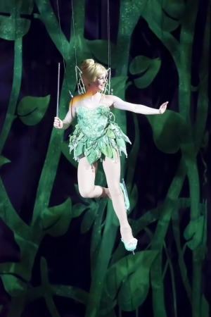 GREEN BAY, WI - MARCH 10:  Waving Tinker Bell from Peter Pan on skates enters on wires at the Disney on Ice Treasure Trove show at the Resch Center on March 10, 2012 in Green Bay, Wisconsin.