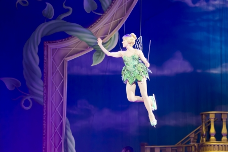 tinker bell: GREEN BAY, WI - MARCH 10:  Tinker Bell from Peter Pan on skates leaves on wires at the Disney on Ice Treasure Trove show at the Resch Center on March 10, 2012 in Green Bay, Wisconsin. Editorial