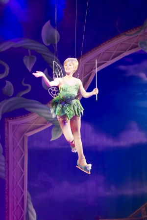 tinker bell: GREEN BAY, WI - MARCH 10:  Waving Tinker Bell from Peter Pan on skates leaves on wires at the Disney on Ice Treasure Trove show at the Resch Center on March 10, 2012 in Green Bay, Wisconsin.