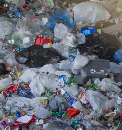 RHINELANDER, WI - AUGUST 27:  We Recycle containter in a Pile of plastic Recyclables at the Oneida County Landfill on August 27, 2011 in Rhinelander, Wisconsin. Stock Photo - 17523099