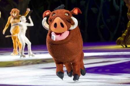 treasure trove: GREEN BAY, WI - MARCH 10:  Pumbaa from The Lion King on skates at the Disney on Ice Treasure Trove show at the Resch Center on March 10, 2012 in Green Bay, Wisconsin. Editorial