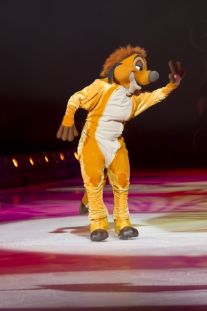 treasure trove: GREEN BAY, WI - MARCH 10:  Waving Timon from The Lion King on skates at the Disney on Ice Treasure Trove show at the Resch Center on March 10, 2012 in Green Bay, Wisconsin.