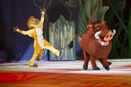 treasure trove: GREEN BAY, WI - MARCH 10:  Timon and Pumbaa skating from The Lion King on skates at the Disney on Ice Treasure Trove show at the Resch Center on March 10, 2012 in Green Bay, Wisconsin.