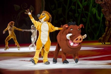 treasure trove: GREEN BAY, WI - MARCH 10:   Waving Timon and Pumbaa from The Lion King on skates at the Disney on Ice Treasure Trove show at the Resch Center on March 10, 2012 in Green Bay, Wisconsin.