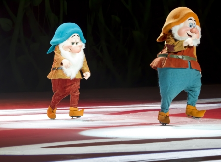 bashful: GREEN BAY, WI - MARCH 10: Bashful and Happy Dwarves from Snow White in skates at the Disney on Ice Treasure Trove show at the Resch Center on March 10, 2012 in Green Bay, Wisconsin. Editorial
