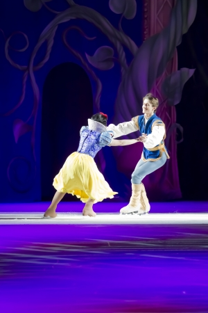 treasure trove: GREEN BAY, WI - MARCH 10: Snow White and Prince Charming skating fast at the Disney on Ice Treasure Trove show at the Resch Center on March 10, 2012 in Green Bay, Wisconsin.