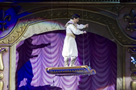 treasure trove: GREEN BAY, WI - MARCH 10:  Aladdin and the Magic Carpet from Aladdin at the Disney on Ice Treasure Trove show at the Resch Center on March 10, 2012 in Green Bay, Wisconsin.