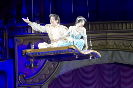treasure trove: GREEN BAY, WI - MARCH 10:  Waving Aladdin and Jasmine on the Magic Carpet from Aladdin at the Disney on Ice Treasure Trove show at the Resch Center on March 10, 2012 in Green Bay, Wisconsin.