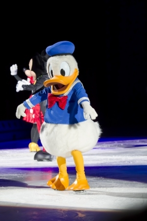 donald: GREEN BAY, WI - MARCH 10: Donald Duck in blue shirt and skates at the Disney on Ice Treasure Trove show at the Resch Center on March 10, 2012 in Green Bay, Wisconsin.