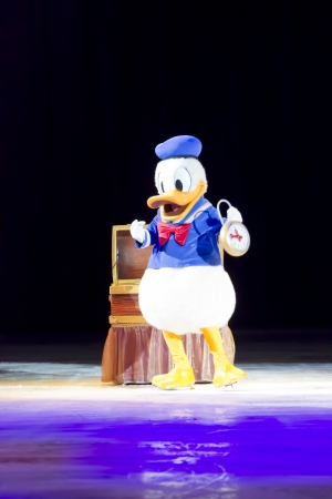 donald: GREEN BAY, WI - MARCH 10: Donald Duck in blue shirt and skates with a clock at the Disney on Ice Treasure Trove show at the Resch Center on March 10, 2012 in Green Bay, Wisconsin.