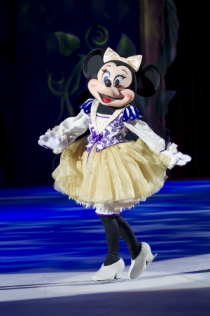 treasure trove: GREEN BAY, WI - MARCH 10: Minnie Mouse taking a curtsy in a purple outfit and skates at the Disney on Ice Treasure Trove show at the Resch Center on March 10, 2012 in Green Bay, Wisconsin.