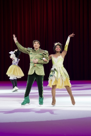 treasure trove: GREEN BAY, WI - MARCH 10: Waving Prince Naveen and Princess Tiana from Princess and the Frog on skates at the Disney on Ice Treasure Trove show at the Resch Center on March 10, 2012 in Green Bay, Wisconsin.