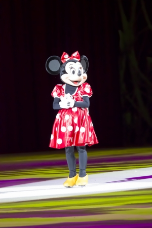 minnie mouse: GREEN BAY, WI - MARCH 10: Minnie Mouse in a red dress and skates at the Disney on Ice Treasure Trove show at the Resch Center on March 10, 2012 in Green Bay, Wisconsin.
