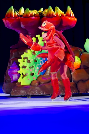 treasure trove: GREEN BAY, WI - MARCH 10: Red Sebastian the Crab by coral from Little Mermaid on skates at the Disney on Ice Treasure Trove show at the Resch Center on March 10, 2012 in Green Bay, Wisconsin.