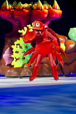 treasure trove: GREEN BAY, WI - MARCH 10: Laughing Sebastian the Crab by coral from Little Mermaid on skates at the Disney on Ice Treasure Trove show at the Resch Center on March 10, 2012 in Green Bay, Wisconsin.
