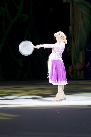 rapunzel: GREEN BAY, WI - MARCH 10: Rapunzel with pan from Tangled on skates at the Disney on Ice Treasure Trove show at the Resch Center on March 10, 2012 in Green Bay, Wisconsin.