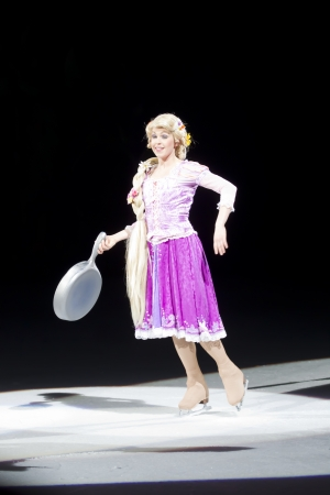 GREEN BAY, WI - MARCH 10: Skating Rapunzel with pan from Tangled on skates at the Disney on Ice Treasure Trove show at the Resch Center on March 10, 2012 in Green Bay, Wisconsin. Sajtókép