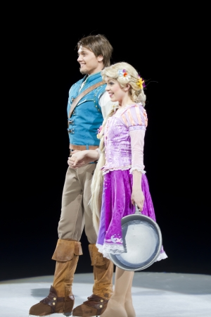 treasure trove: GREEN BAY, WI - MARCH 10: Rapunzel and Flynn Rider from Tangled on skates at the Disney on Ice Treasure Trove show at the Resch Center on March 10, 2012 in Green Bay, Wisconsin. Editorial