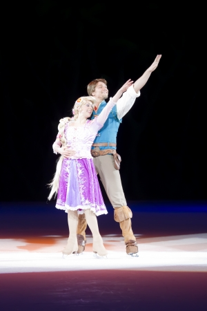 rapunzel: GREEN BAY, WI - MARCH 10: Together are Rapunzel and Flynn Rider from Tangled on skates at the Disney on Ice Treasure Trove show at the Resch Center on March 10, 2012 in Green Bay, Wisconsin. Editorial