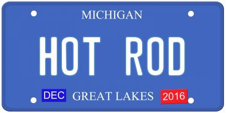 Een imitatie van Michigan kenteken met december 2016 stickers en HOT ROD geschreven op het maken van een grote Detroit of Michigan auto concept. Woorden op de bodem van de Grote Meren. Stockfoto
