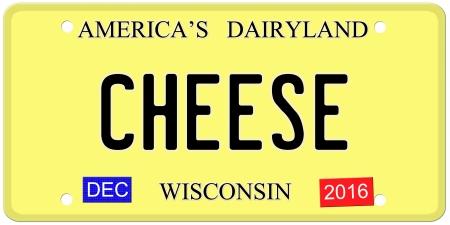 Een imitatie van Wisconsin kentekenplaat met december 2016 stickers en KAAS geschreven op het maken van een geweldig concept. Woorden op de top Amerika's Dairyland. Stockfoto