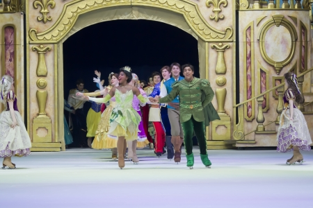 treasure trove: GREEN BAY, WI - MARCH 10: Tiana and Princesses on skates all gather at the end of the show at the Disney on Ice Treasure Trove show at the Resch Center on March 10, 2012 in Green Bay, Wisconsin.