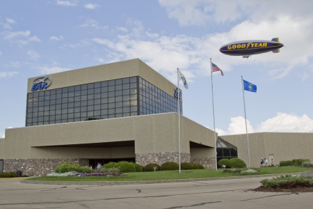 OSHKOSH, WI - JULY 27: GoodYear Blimp Spirit of above EAA Headquarters Building at the 2012 AirVenture at EAA on July 27, 2012 in Oshkosh, Wisconsin. Stock Photo - 17862872