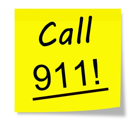 Call 911! written on a square yellow sticky piece of paper. Stock Photo - 17996222