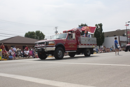 smaller: SEYMOUR, WI - AUGUST 4:  Flags fly on Black Creek Rural Fire Department Smaller Truck at the Annual Hamburger Festival Parade on August 4, 2012 in Seymour, Wisconsin.