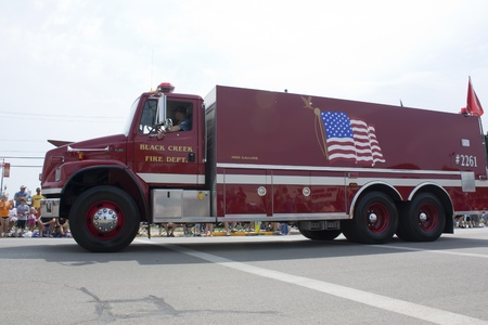 freightliner: SEYMOUR, WI - AUGUST 4:  Side View of Freightliner Black Creek Fire Department Truck at the Annual Hamburger Festival Parade on August 4, 2012 in Seymour, Wisconsin.