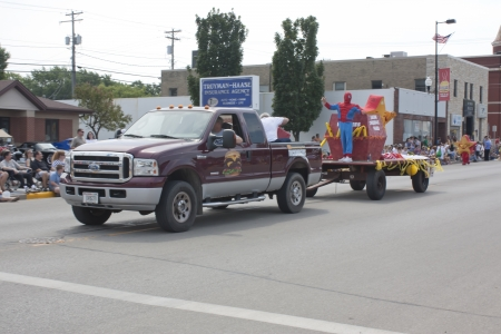 spider man: SEYMOUR, WI - AUGUST 4:  Truck pulling Hardees Float with Star and Spider Man at the Annual Hamburger Festival Parade on August 4, 2012 in Seymour, Wisconsin.