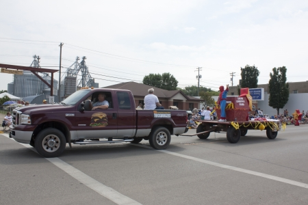 spider man: SEYMOUR, WI - AUGUST 4:  Side view of Truck pulling Hardees Float with Star and Spider Man at the Annual Hamburger Festival Parade on August 4, 2012 in Seymour, Wisconsin.