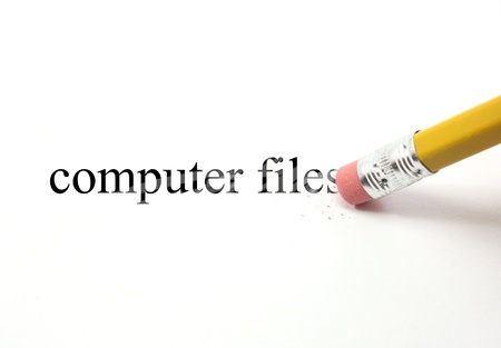 eraser mark: The words computer files written on white with the end of a pencil erasing the black letters showing eraser marks making a great concept. Stock Photo