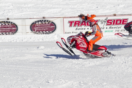 polaris: EAGLE RIVER, WI - MARCH 2:  Polaris Red and white Snowmobile Racing during a race on March 2, 2013 in Eagle River, Wisconsin.