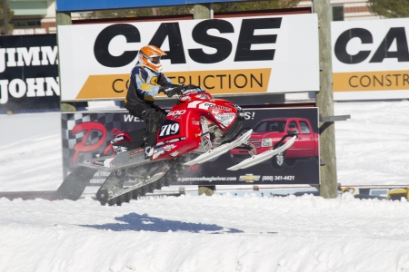 polaris: EAGLE RIVER, WI - MARCH 2:  Polaris Red and black Snowmobile Getting some Air during a race on March 2, 2013 in Eagle River, Wisconsin.